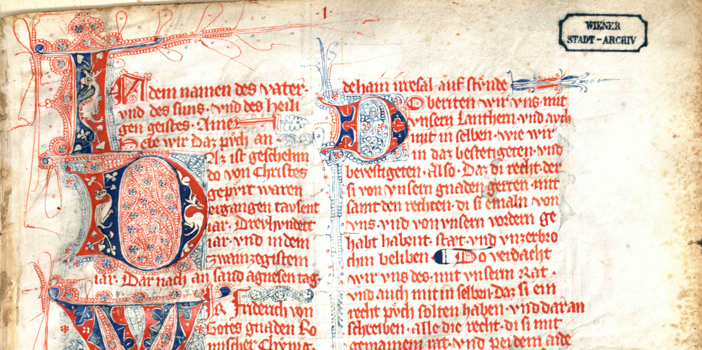 Detailansicht des Eisenbuches mit aufwendiger Schriftkaligrafie